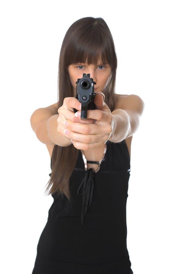 Muchacha hermosa que sostiene una arma de mano foto de archivo libre de regalías