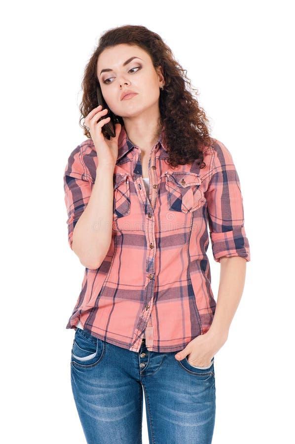Muchacha infeliz con el teléfono portátil imagenes de archivo