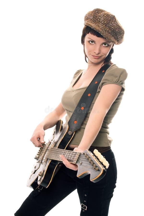 Muchacha joven de la música de la belleza con la guitarra foto de archivo