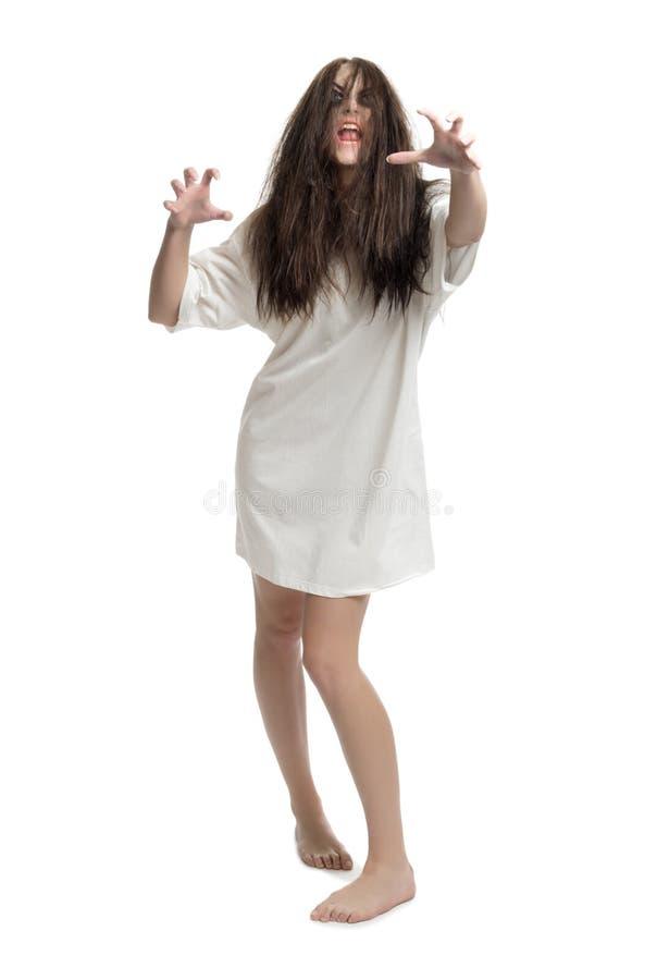 Muchacha joven del zombi aislada fotografía de archivo