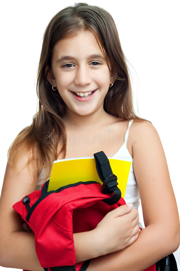 Muchacha latina linda que lleva su morral de la escuela fotos de archivo libres de regalías