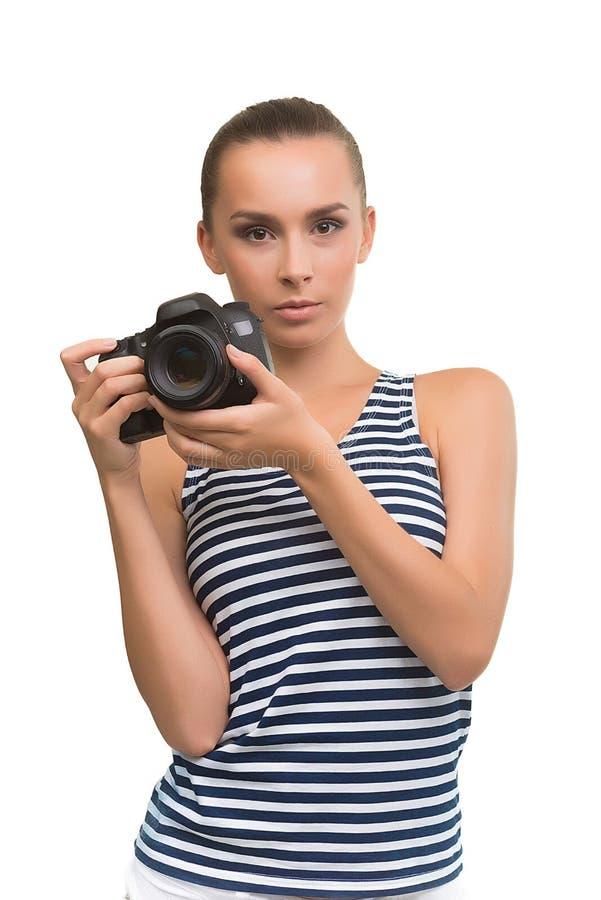 Muchacha linda con la cámara imagen de archivo libre de regalías