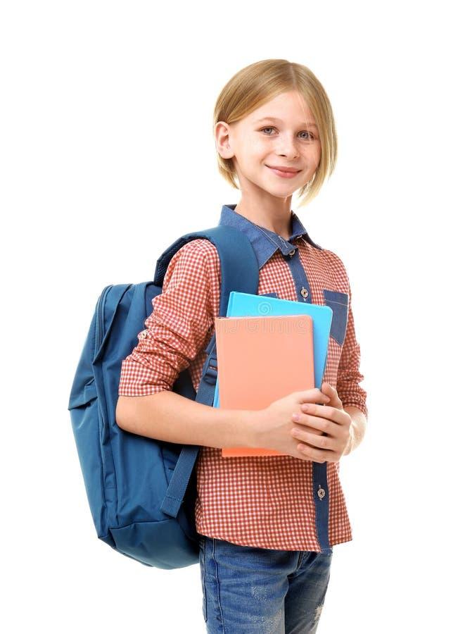 Muchacha linda del adolescente que sostiene los cuadernos, aislados en blanco fotografía de archivo libre de regalías