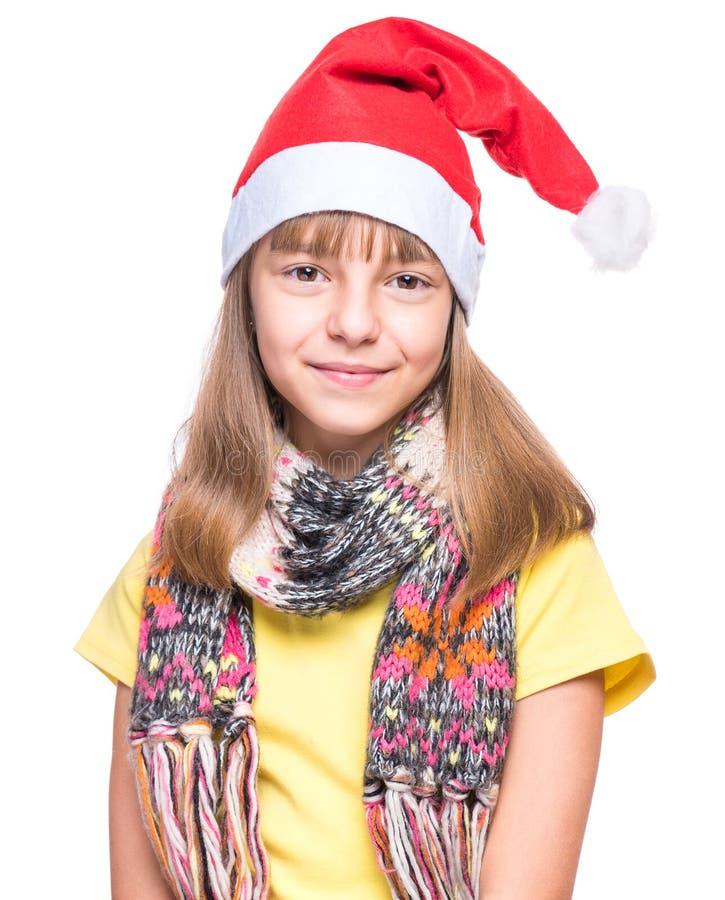 Muchacha linda que lleva el sombrero de Santa Claus imágenes de archivo libres de regalías