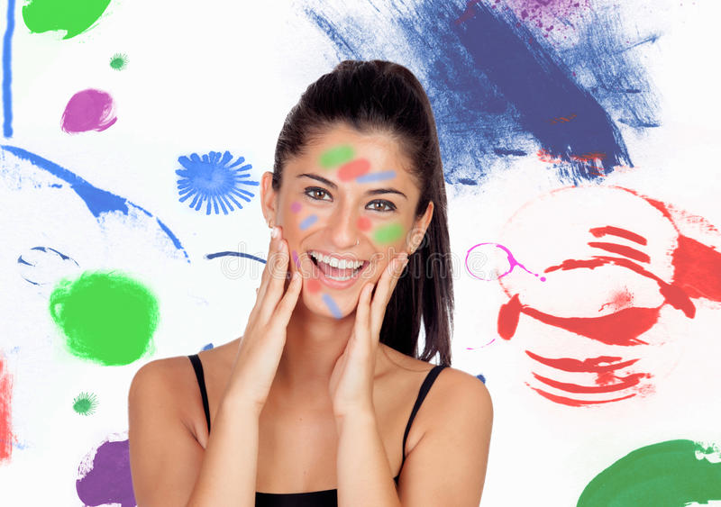 Muchacha morena atractiva con su cara pintada fotografía de archivo libre de regalías