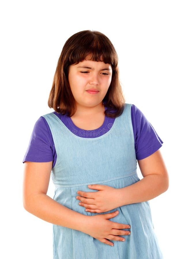 Muchacha morena con dolor de estómago foto de archivo