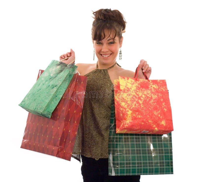Muchacha, mostrando los bolsos de compras fotos de archivo
