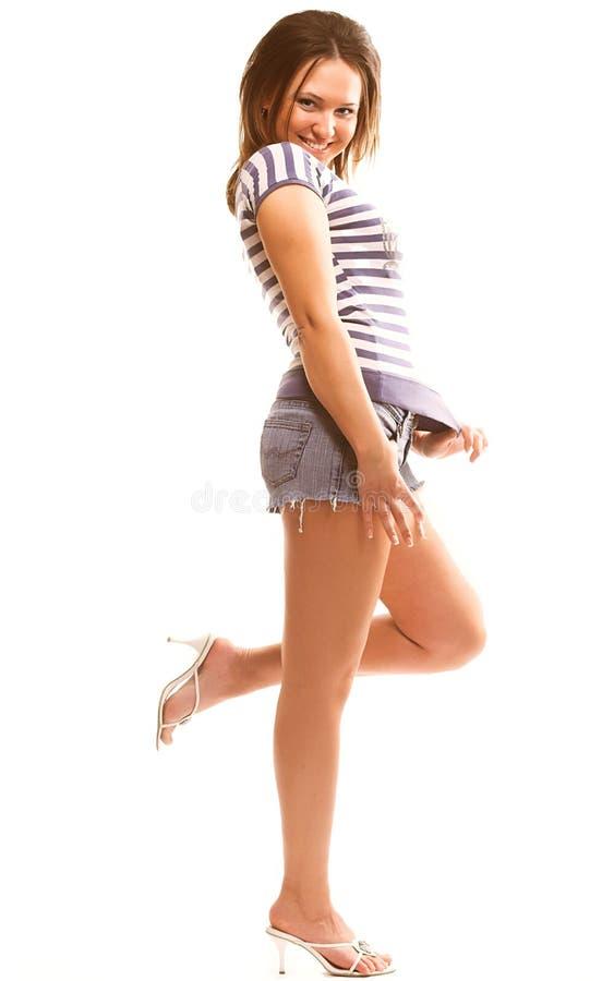 muchacha preciosa en desgaste colorido sobre blanco imágenes de archivo libres de regalías