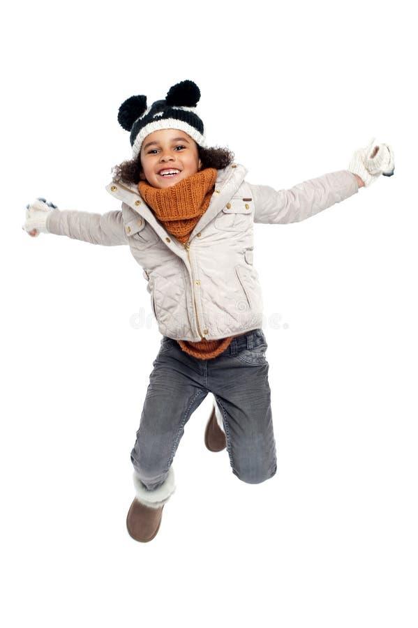 Muchacha primaria emocionada que salta con alegría foto de archivo libre de regalías
