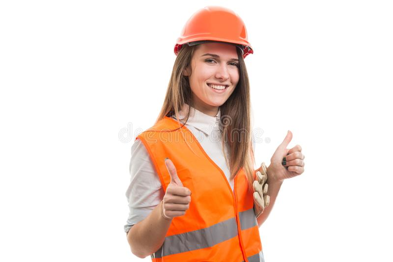 Muchacha profesional feliz del constructor con ambos pulgares para arriba fotografía de archivo libre de regalías