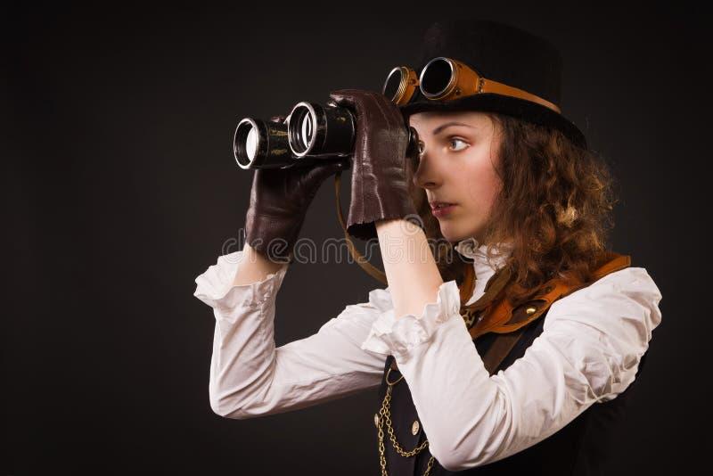 Muchacha punky del vapor con binocular foto de archivo libre de regalías