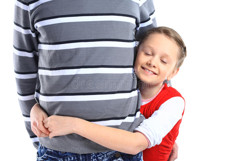 Muchacha que abraza a su padre foto de archivo