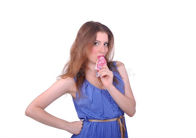 muchacha que come un caramelo grande fotografía de archivo libre de regalías