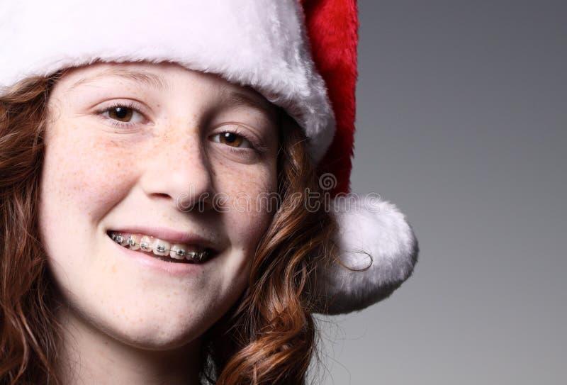 Muchacha que desgasta un sombrero de Santa foto de archivo