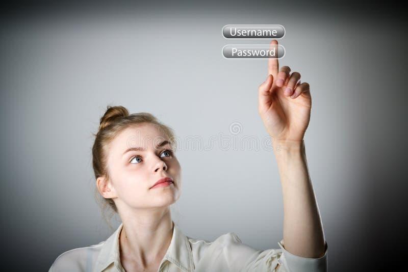 Muchacha que empuja el botón Conexión y palabra de paso imágenes de archivo libres de regalías