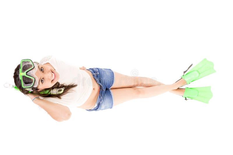 Muchacha que juega con el regulador de inmersión. Aislado. imagen de archivo