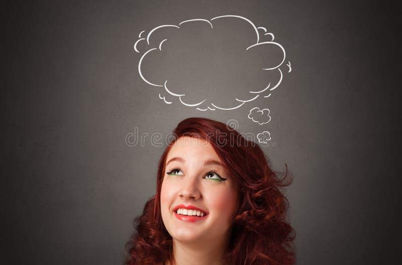 Muchacha que piensa con concepto de la burbuja del discurso fotografía de archivo libre de regalías