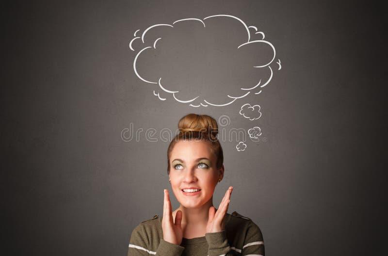 Muchacha que piensa con concepto de la burbuja del discurso imagen de archivo libre de regalías