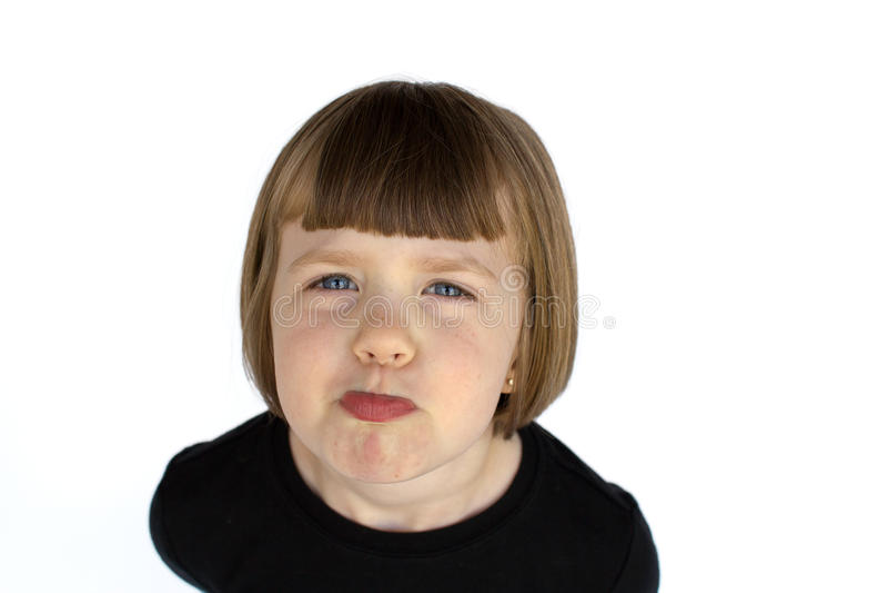 Muchacha que pone mala cara fotografía de archivo