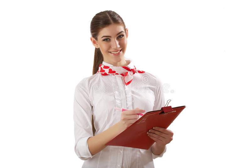 Muchacha que se coloca con la carpeta foto de archivo libre de regalías