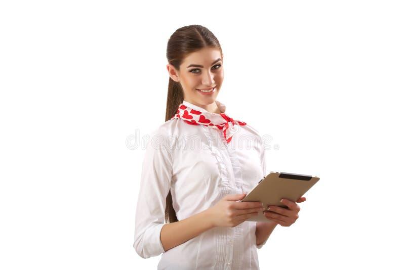 Muchacha que se coloca con la tableta fotografía de archivo