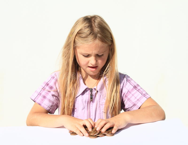 Muchacha que sostiene el dinero imagen de archivo
