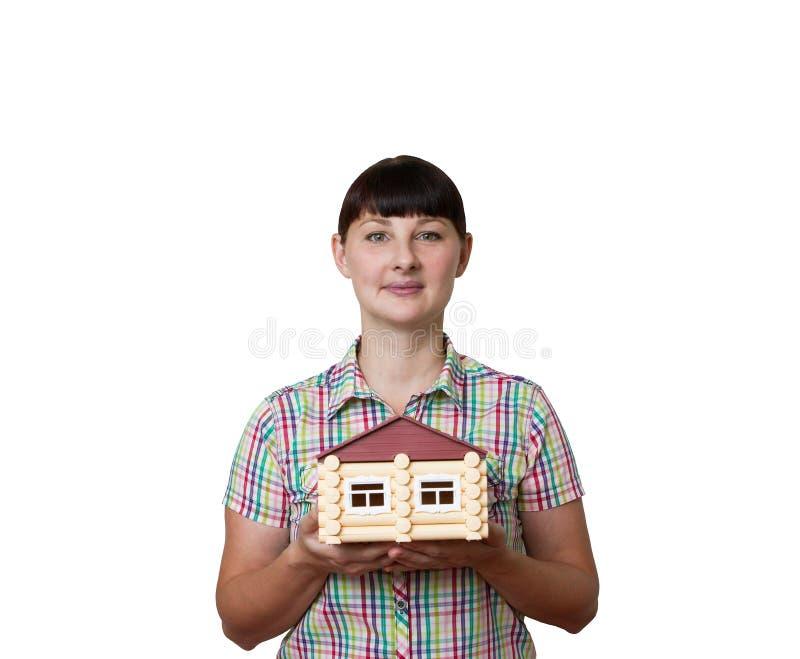 Muchacha que sostiene una casa imagen de archivo