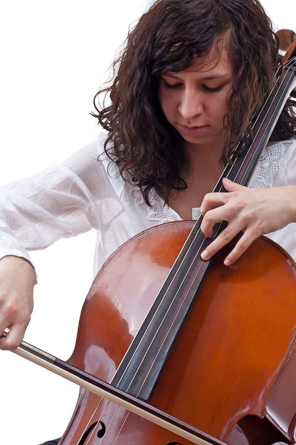 Muchacha que toca el violoncelo imagenes de archivo