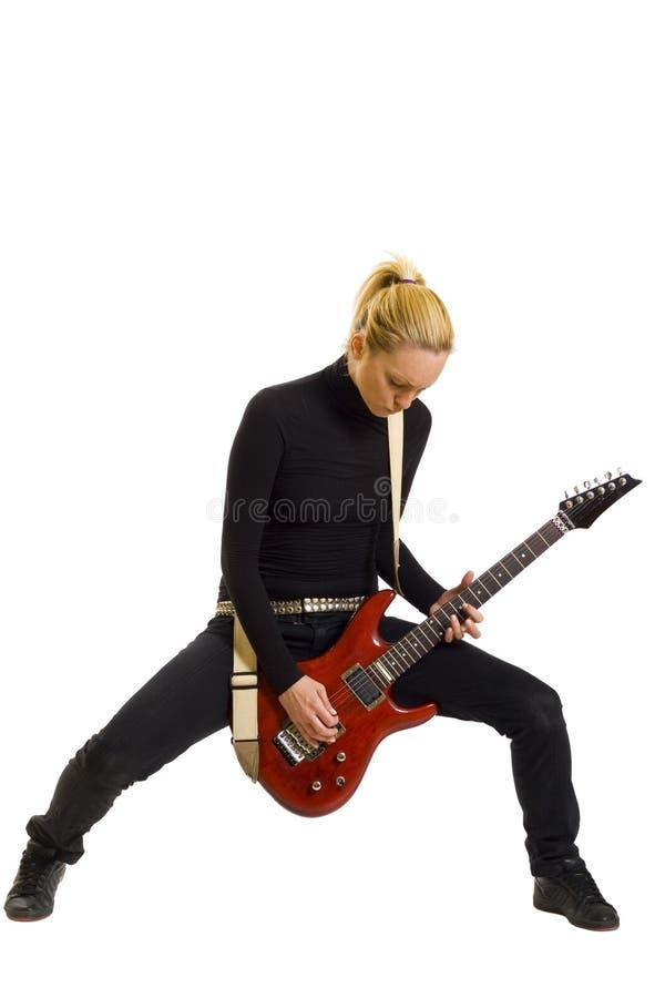 Muchacha que toca la guitarra eléctrica imágenes de archivo libres de regalías