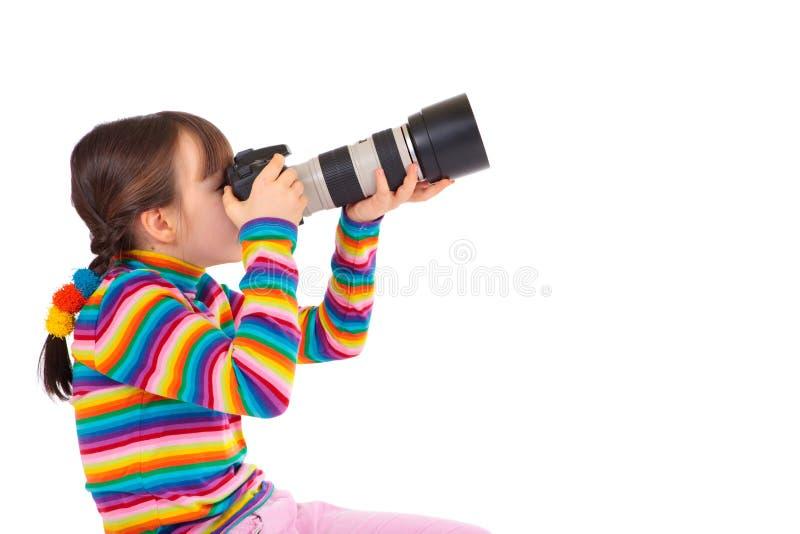 Muchacha que toma cuadros foto de archivo
