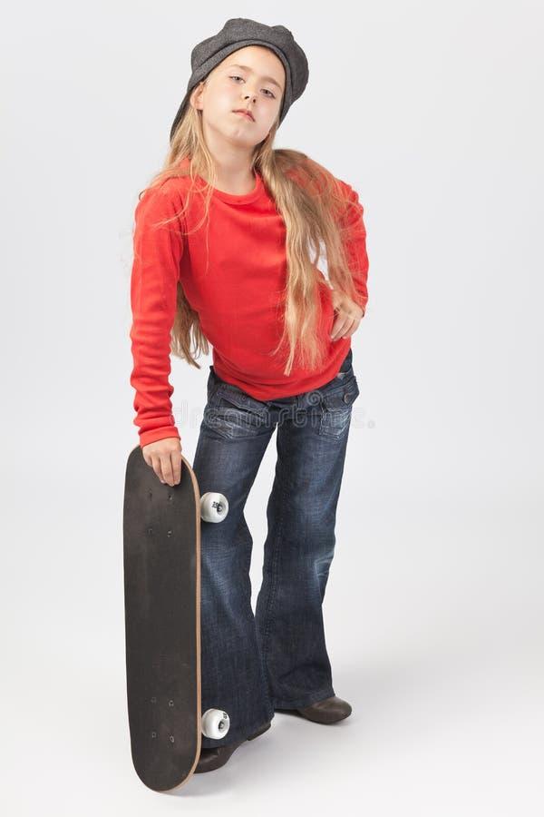 Muchacha resistente del patinador foto de archivo libre de regalías