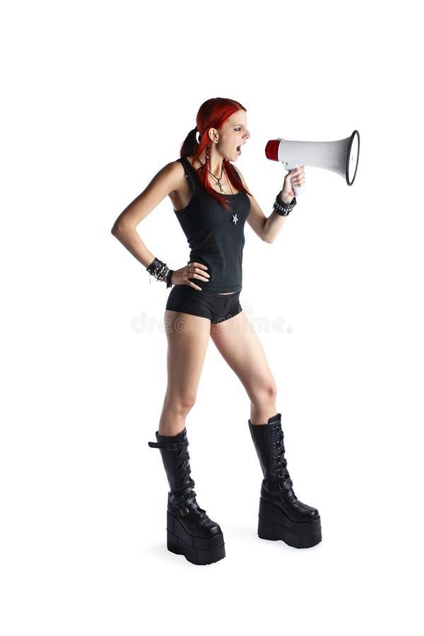 Muchacha roja hermosa del pelo con el megáfono foto de archivo