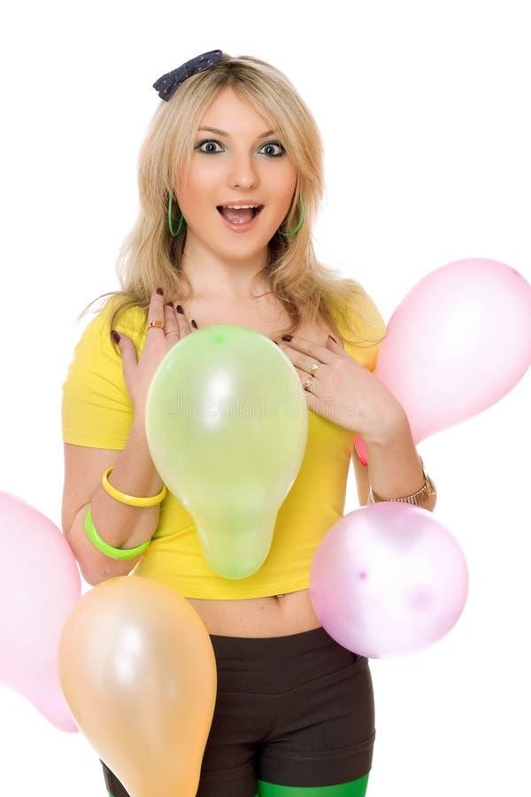 Muchacha rubia bastante atractiva con los globos fotografía de archivo libre de regalías