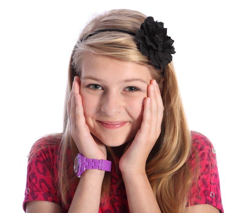 Muchacha rubia joven emocionada de la escuela con sonrisa linda fotografía de archivo