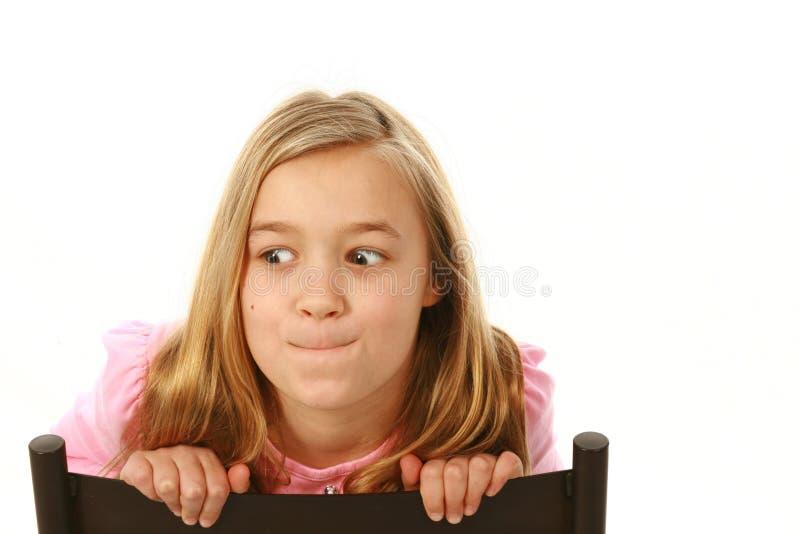 Muchacha rubia que hace una cara fotografía de archivo libre de regalías