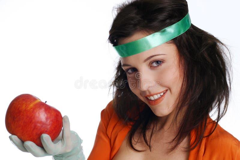 Muchacha sonreída con la manzana fotografía de archivo libre de regalías
