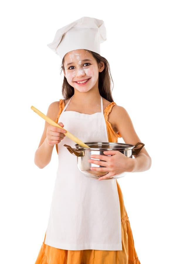 Muchacha sonriente con el pote y la cucharón imágenes de archivo libres de regalías