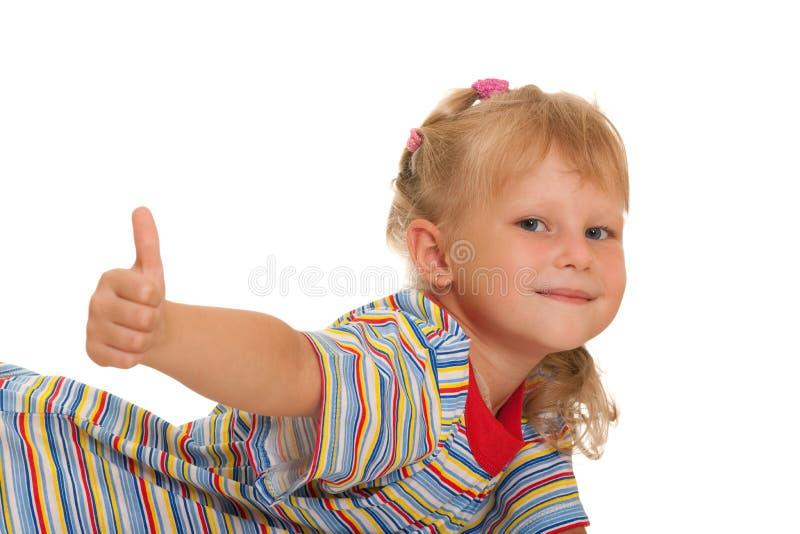 Muchacha sonriente con el pulgar para arriba imagen de archivo