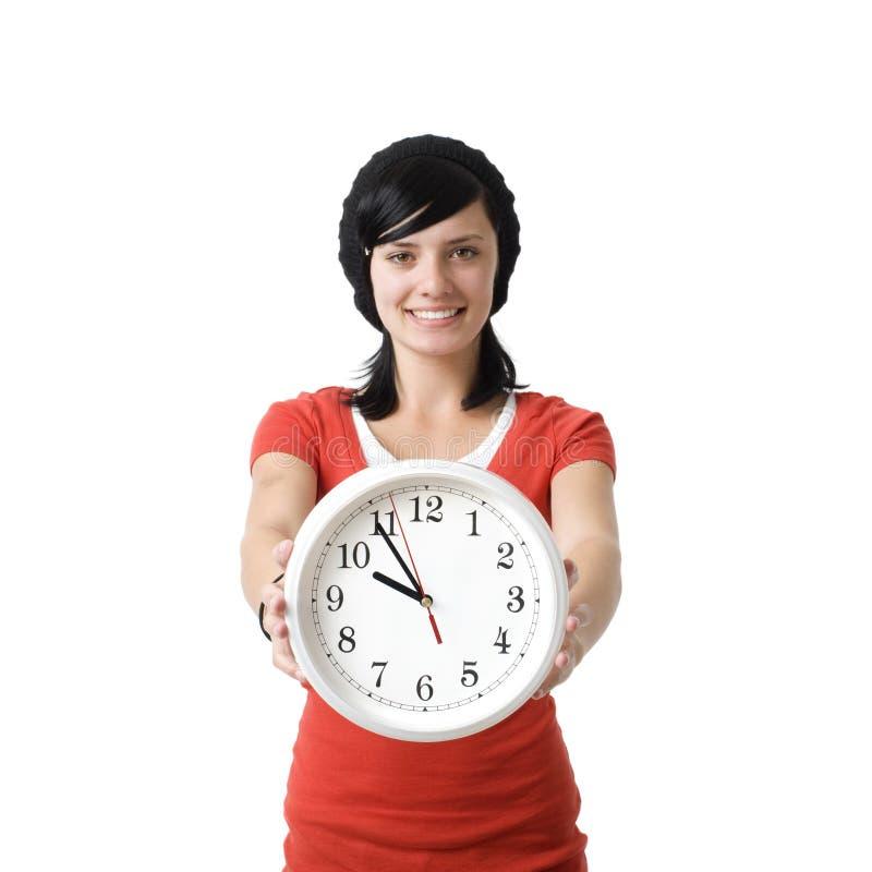 Muchacha sonriente con el reloj fotos de archivo libres de regalías