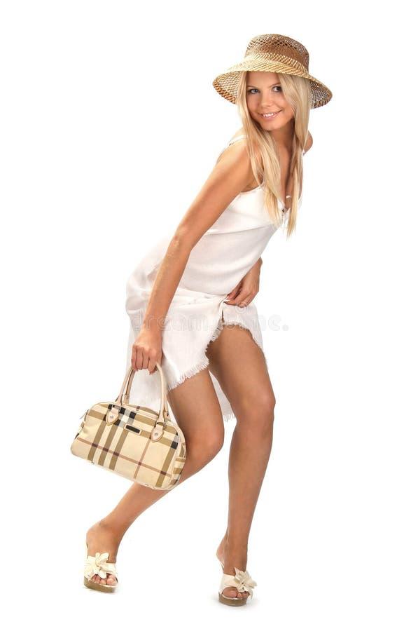 Muchacha sonriente con un bolso foto de archivo