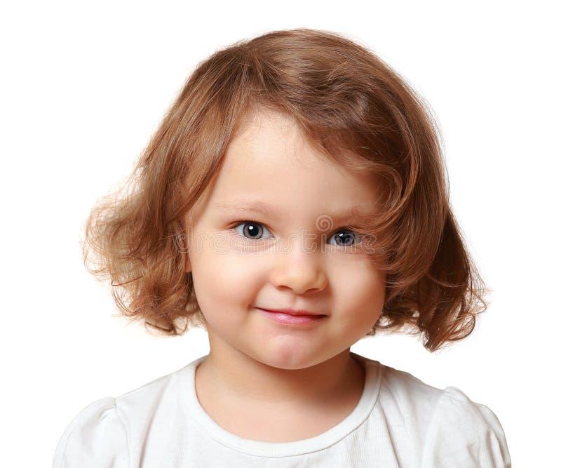 Muchacha sonriente hermosa del niño aislada imagenes de archivo