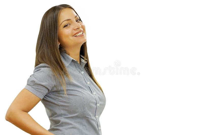 Muchacha sonriente joven en perfil a la cintura aislada en el fondo blanco fotografía de archivo libre de regalías