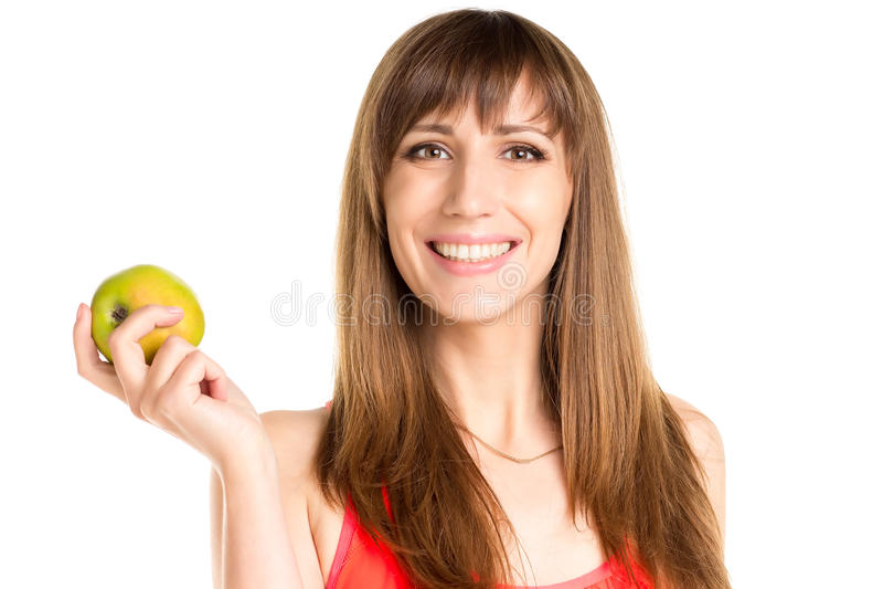 Muchacha sonriente joven que sostiene la manzana verde disponible Mujer de la aptitud foto de archivo
