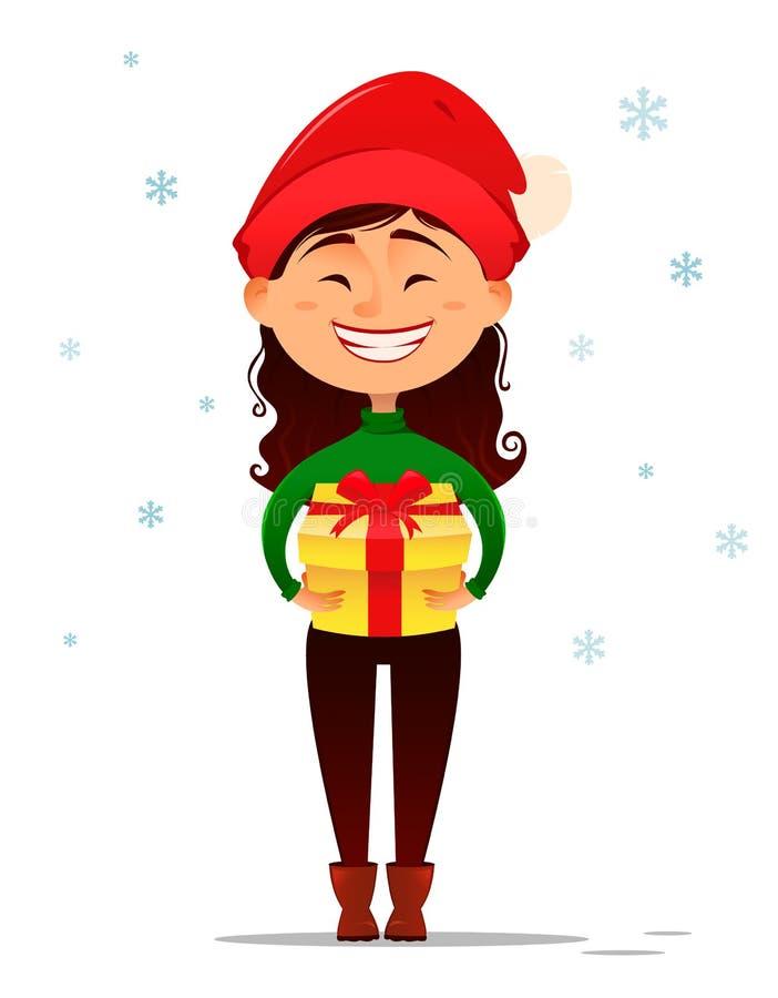 Muchacha sonriente linda en el sombrero de la Navidad que sostiene la caja de regalo en sus manos stock de ilustración