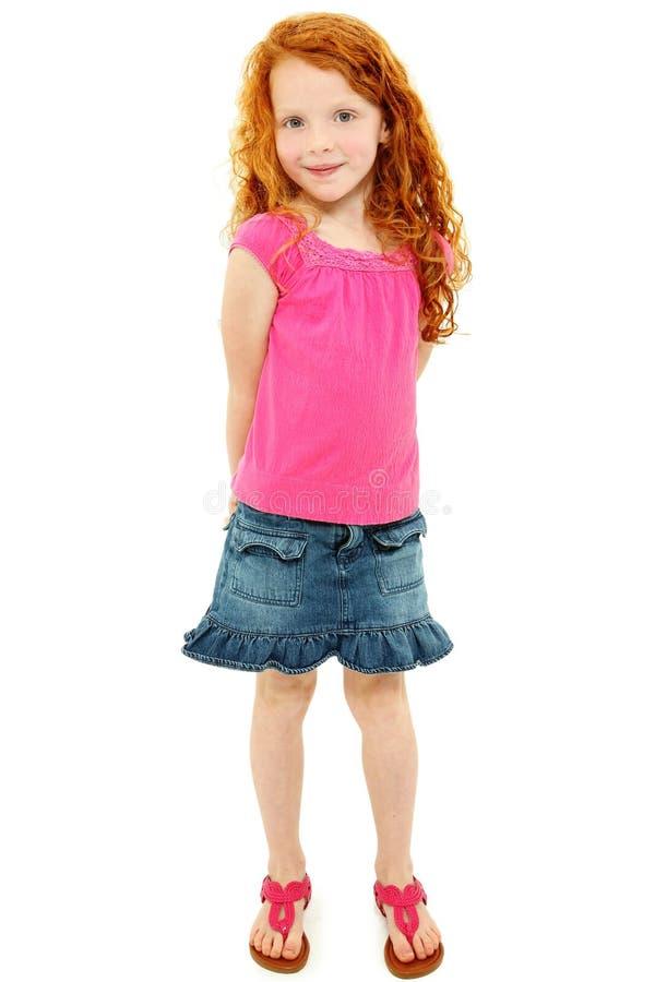 Muchacha tímida hermosa de la escuela del Redhead sobre blanco imágenes de archivo libres de regalías