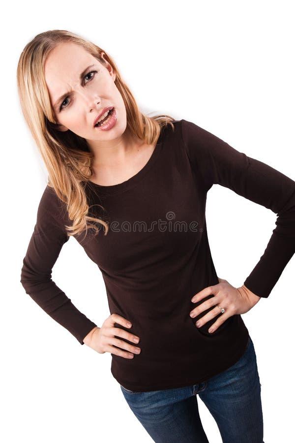 Muchacha trastornada con las manos en caderas fotografía de archivo