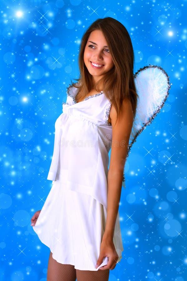 Muchacha vestida como ángel fotografía de archivo