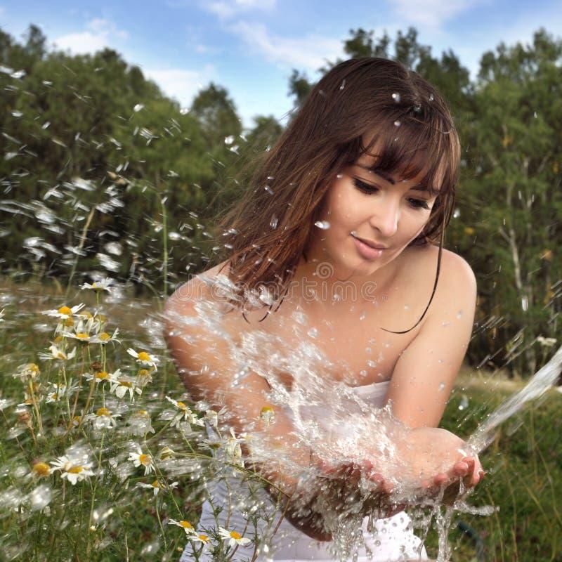 Muchacha y agua imagen de archivo libre de regalías