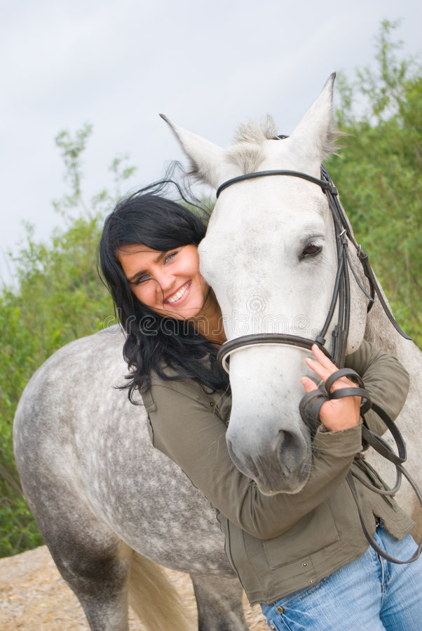 Muchacha y caballo hermosos. imagen de archivo