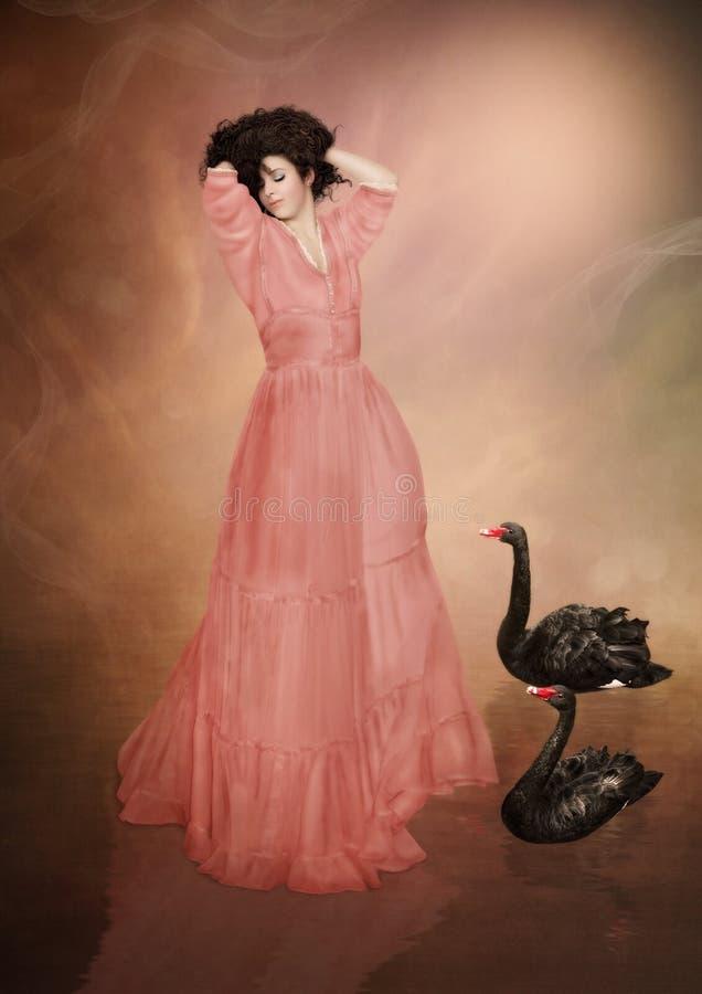 Muchacha y cisnes negros imagen de archivo